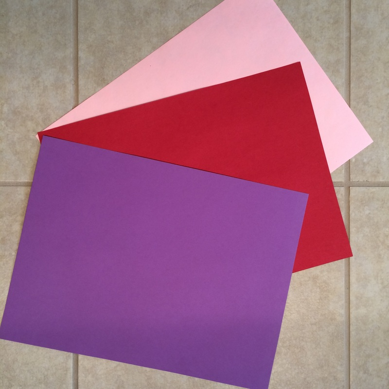 Assorted Valentine's Day Construction Paper Colors // Family Folding Hearts from GrowingLittleLeaves.com